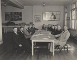 Group of men seated around a table at the office of the Alabama Chamber of Commerce on Dexter...