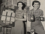 Mrs. Preston Shaw displaying new packaging to be used by the Chilton County Fruit and Truck...