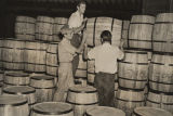 Men stacking barrels at the egg drying plant of the Dennison Egg and Poultry Company in...