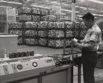"""Engine pistons made at Ford Motor Company's Sheffield, Ala., plant move by conveyor through..."