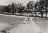 Two boys and two women on the dirt path leading away from the beach at Lake Jackson in Florala,...