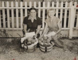 Mrs. Lonnie Minor and Mrs. Clyde Headly, winners at a peach auction in Chilton County, Alabama,...