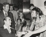 Governor George Wallace shaking hands with a young woman at the Capitol in Montgomery, Alabama,...