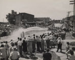 Crowd gathered in downtown Florala, Alabama, to watch two teams of men spray each other with fire...