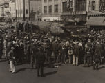 Crowd gathered around a captured Japanese submarine on trailer in downtown Montgomery, Alabama,...