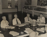 Men seated around a table at the office of the Alabama Chamber of Commerce on Dexter Avenue in...