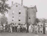 African American children outside a brick school building in Montgomery, Alabama.