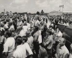 Crowd at Dannelly Field in Montgomery, Alabama, waiting for the return of Governor George Wallace...