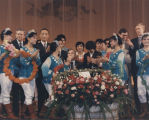 Governor George Wallace on stage with dancers and dignitaries during his visit to China.