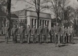 Student soldiers marching on the quad in front of Gorgas Library at the University of Alabama.