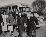 Students getting off a school bus in Alabama.
