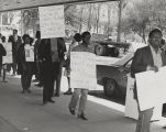 Participants in a civil rights demonstration on a sidewalk in downtown Birmingham, Alabama.