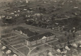 Aerial view of the school building constructed by the West Point Manufacturing Company in Lanett,...