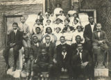 Aaron Frazier seated with a group of young men and women.