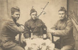 Dewey Morris of Flomaton, Alabama, with two other soldiers.