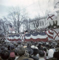 Governor Jim Folsom speaking at the podium in front of the Capitol in Montgomery, Alabama, at his...
