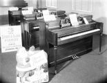 Three Story and Clark pianos at Forbes Piano Company in Montgomery, Alabama.