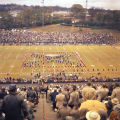 Marching band forming a rebel flag on the field during halftime of the Blue-Gray game at Cramton...