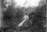 Annie Pfaff seated on a rock beside Mahan Creek at Brierfield, Alabama.