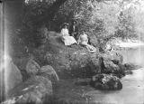 Annie Pfaff and others, seated on a rock beside Mahan Creek at Brierfield, Alabama.