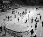 Pole vaulter performing during a track meet at Garrett Coliseum in Montgomery, Alabama.