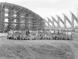 Construction crew in front of the skeleton of Garrett Coliseum in Montgomery, Alabama.