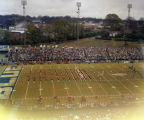 Marching bands performing on the field at the Blue-Gray game at Cramton Bowl in Montgomery,...