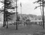 Uniformed girls saluting the American flag at a Girl Scout camp in Oak Mountain State Park in...