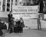Woman and two little girls in front of the Capitol in Montgomery, Alabama, during a March of Dimes...