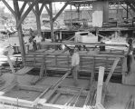 Workers stacking planks at the Cathey Lumber Company in Montgomery, Alabama.