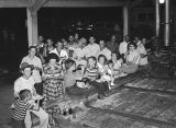 Hunter Flack and employees during a company picnic at the yard of the J. H. Flack Lumber Company...