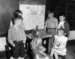 Students at Goode Street School in Montgomery, Alabama, gathered around a live chicken in their...