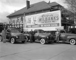 Trucks and salesmen outside the Wilbanks Motor Service building in Montgomery, Alabama.