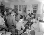 Men at a diner in Demopolis, Alabama, gathered to watch the World Series on a small television set.