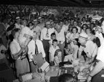 Crowd gathered during an auction at the Lions barbecue at Pratt Parkin Prattville, Alabama.