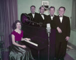 Eads Quartet standing behind a piano WBAM, a radio station in Montgomery, Alabama.