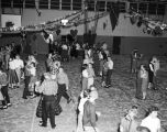 Couples dancing in the gym during a dance at Capitol Heights Junior High School in Montgomery,...