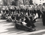 Selma to Montgomery marchers sitting surrounded by Montgomery police.
