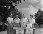 Cleve Stokes and three other men in Pratt Park in Prattville, Alabama, standing with the first bag...