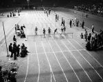 Runners on the track during a college track meet at Garrett Coliseum in Montgomery, Alabama.