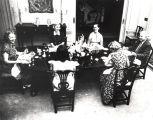 Governor and Mrs. Persons and family at the dining room table in the Governor's Mansion.