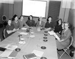 Women at a training session for Field Enterprises, publishers of the CHILDCRAFT series.