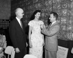 Three guests standing and talking at a dinner given by Jefferson Standard Life Insurance Company...