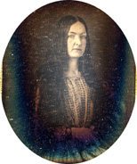 Woman in gingham dress with long hair.