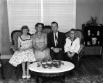 Four members of the Curenton family seated on a living room sofa.
