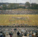 Marching band forming a Confederate flag on the field during halftime of the Blue-Gray game at...