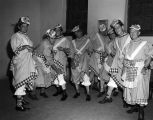 Men wearing in dresses, bows, and bloomers backstage during an Optimist Club minstrel show at...