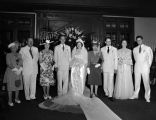 Bride and groom of the Kewtus-Levy wedding with their parents and family, standing in front of the...