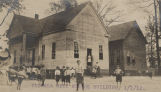Children in front of a city school building in Florala, Alabama.
