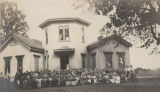 Students and teachers in front of a school building in rural Madison County, Alabama.
